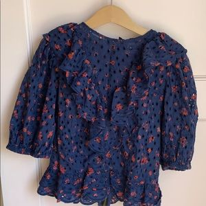 Red dotted navy blue zip up ruffled blouse